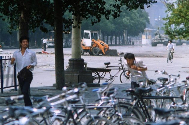 The moment leading up to the Tiananmen Square stand off. The lone man can be seen holding his ground in the left of the picture with the advancing tanks on the right. Photo by Terril Jones.