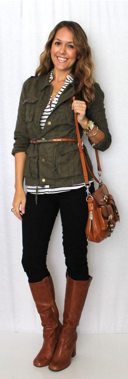Military jacket buttoned over striped shirt and belted with dark denim