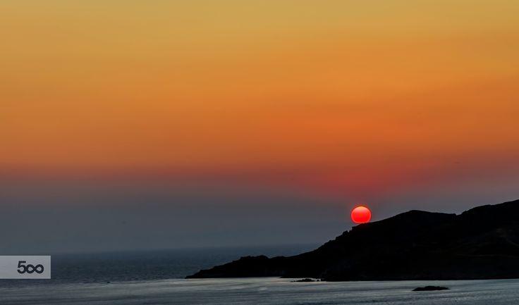 Stunning Summer Sunset with the sun looking like a giant orange balloon.