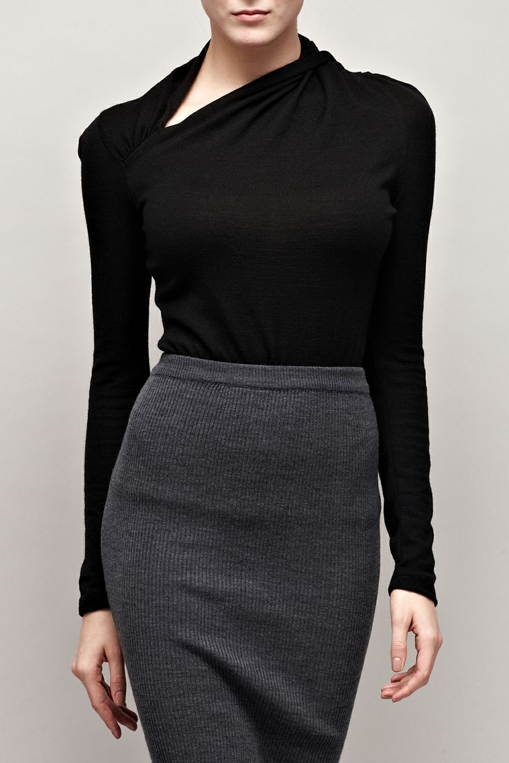 Black Asymmetric Sweater: Distracts from a slack jaw - stay away from high necks & cluttering scarves