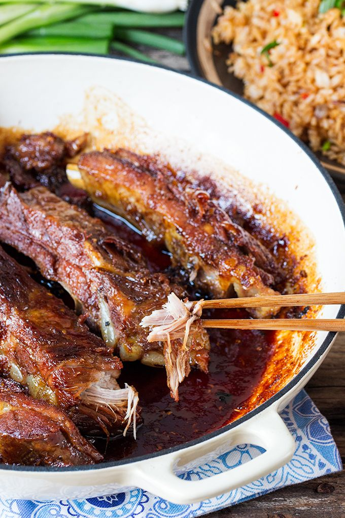 Fall apart pork ribs with a golden crispy exterior, covered in a sweet, sticky sauce.  The best ribs I've ever tasted. [Ribs seasoning: ginger, rice wine, garlic, stock. Glaze: soy sauce, ginger, honey, brown sugar, lemongrass paste] #Slow-cooker