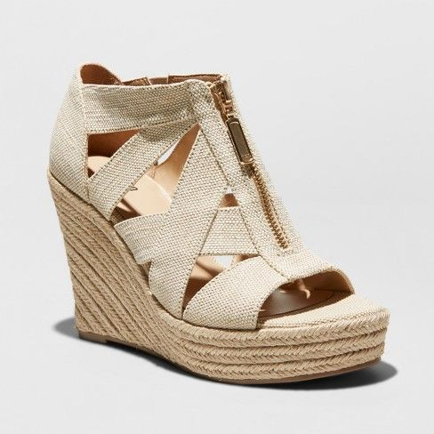 Elevate your warm-weather looks with the Emilee Espadrille Sandals from Mossimo Supply Co.™ With a woven, neutral upper constructed of overlapping straps, these open-toed espadrille sandals are finished off with a gold zipper, making them an easy addition to a variety of looks. These neutral espadrilles add instantly chic style to any look, whether you're wearing a simple T-shirt and frayed shorts or a flowy eyelet sundress.
