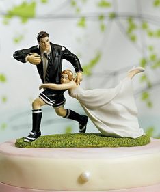 For those in love with each other and in love with the sport of rugby, this figurine is dynamic and totally entertaining. As portrayed by the gravity defying pose, this couple are clearly in the game to win! Dress your cake and mini cakes with rugby stripes to complete the look. Hand painted porcelain. Presently the Bride and Groom Cake Toppers are available with skin tones and hair colors only as shown. #timelesstreasure