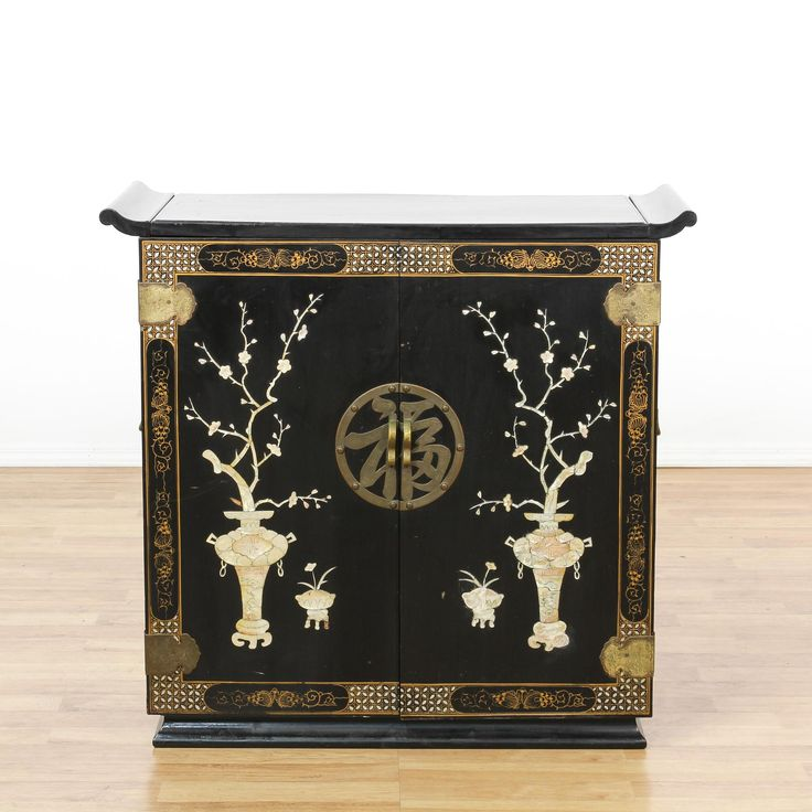 This asian bar cabinet is featured in a solid wood with a glossy black lacquered finish and mother of pearl floral inlays. This buffet sideboard has a carved curved top, a large interior cabinet with a lift up top, shelving and a mirror back. Stunning storage piece perfect for dishes and drinks! #asian #storage #liquorcabinet #sandiegovintage #vintagefurniture