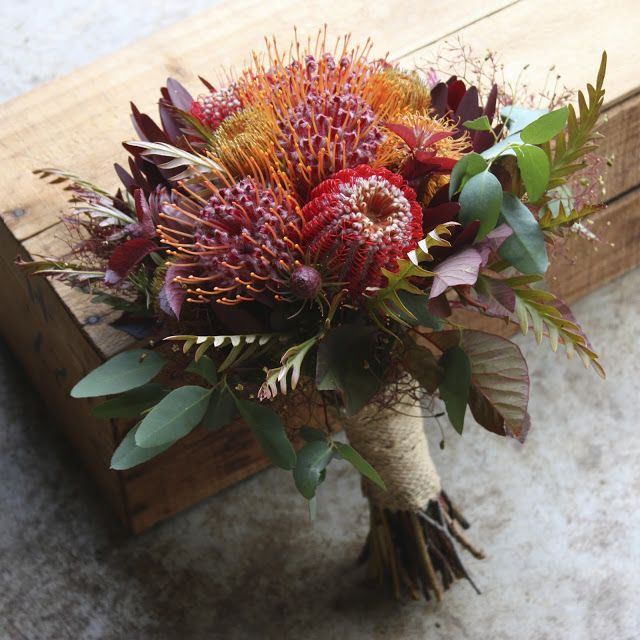 Red and Gold Summer Natives for a December Wedding