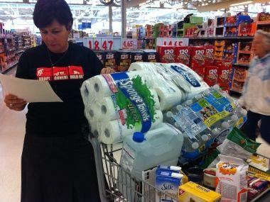 Bernadette Woit of ShakeOut B.C. checks her shopping list for her earthquake kit.