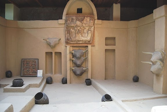 NEOLITHIC - Catal Hüyük  reconstruction of a shrine. c. 5900 BCE. Includes Bull heads from in Angora Museum, Turkey.