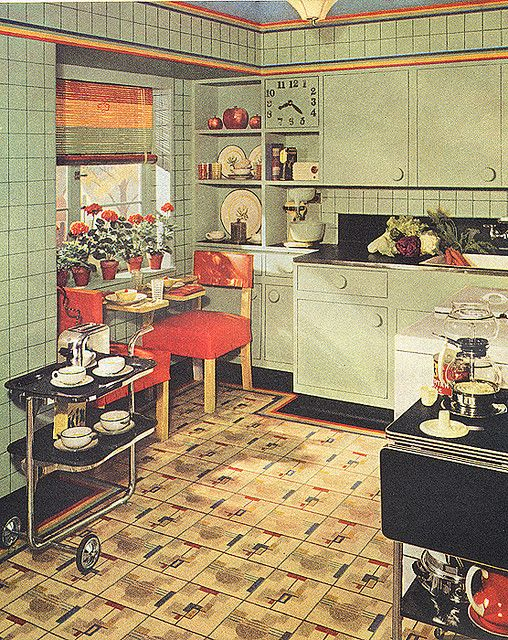 I adore the clock built into the cabinets in this lovely kitchen from 1939.