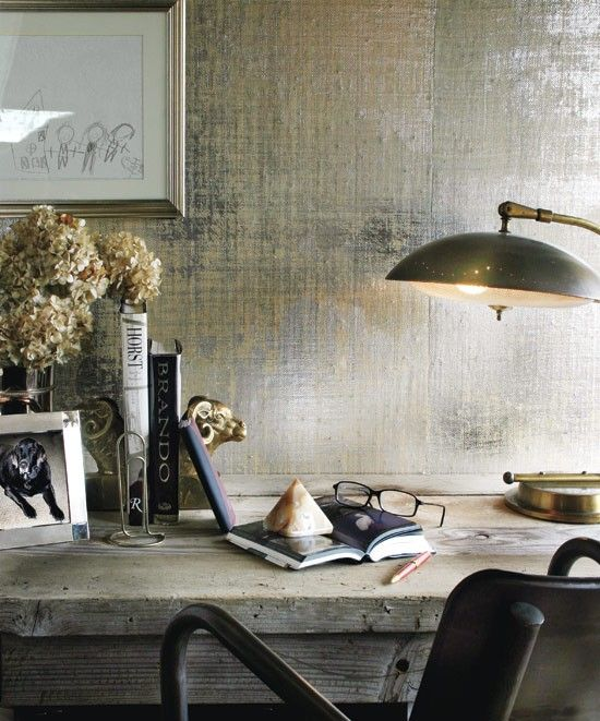 gorgeous subtle metallic wallapaper witho roughed up old table and industrial task lamp. Great styling