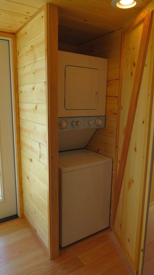 #tumbleweed #tinyhouses #tinyhome #tinyhouseplans Perfect little alcove for a stackable washer/dryer. This could be right outside the door to the bedroom or bathroom. Looks to be located right beside a door to the outside. Just perfect! tillamook-triple-bay-tiny-house-15