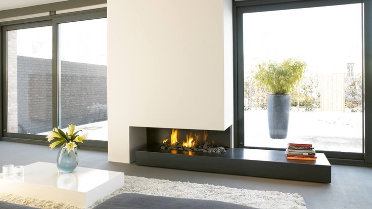 A bespoke fireplace with long decorative base made from bluetseel. As a bespoke fireplace, size of the base can be designed to suit the space in question and the material and finish can also be customised.