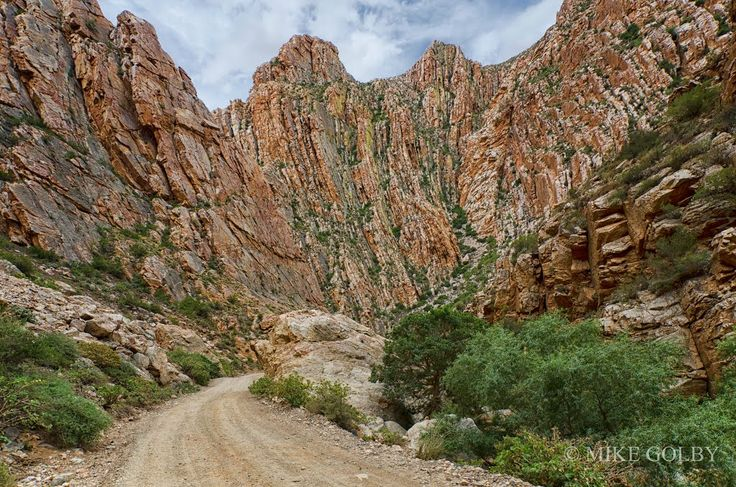 "Entrance to Swartberg Pass. root Swartberg Nature Reserve, South Africa 33° 18' 2.63"" S 22° 3' 3.49"" E"