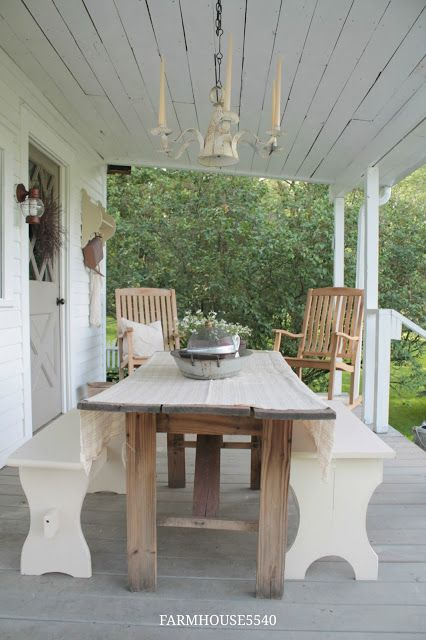 """We just finished the porch roof underside this past weekend. Once again we used cedar fence posts to do the job. I wanted something rustic looking because I was started to feel like the porch was looking too """"new"""" but I also wanted to use something that wouldn't rot. At $100 for all of the cedar it fit right into our budget also. - OUR FARMHOUSE PORCH"""