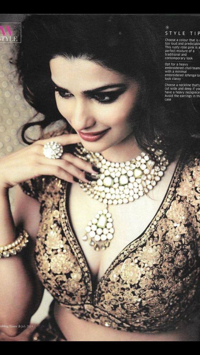 Prachi Desai wears a Sabyasachi blouse and bridal statement necklace and ring.