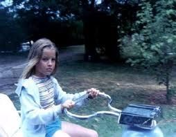 December 25, 1976:  Christmas at Graceland. Elvis gives Lisa Marie a golf cart of her own to ride around the grounds.