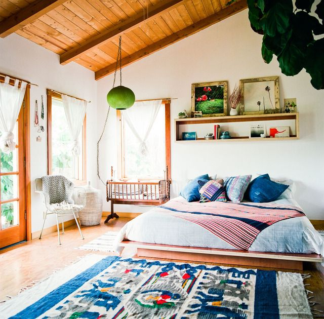Pretty blue & pink hues, lush timber and natural light. Great kilim rug. Such a beautiful boho chic bedroom.