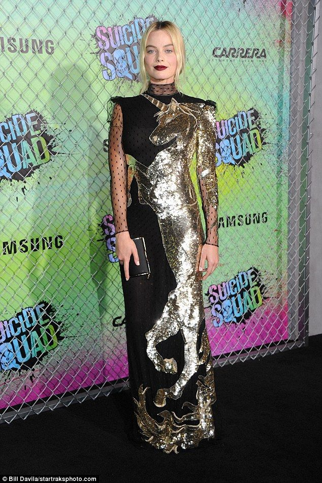 All that glitters: Margot Robbie stood out in a sequined, unicorn-patterned dress at the premiere of Suicide Squad at The Beacon Theater in New…