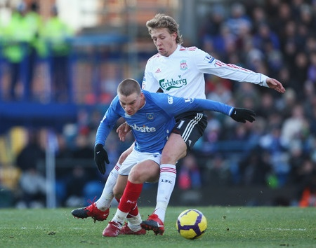 PORTSMOUTH, ENGLAND - DECEMBER 19: Lucas Leiva of Liverpool challenges Jamie O'Hara of Portsmouth during the Barclays Premier League match between Portsmouth and Liverpool at Fratton Park on December 19, 2009 in Portsmouth, England.  (Photo by Bryn Lennon/Getty Images)