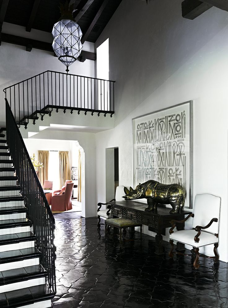 Foyer Stairs Meaning : Art and accessories really modernize this traditional