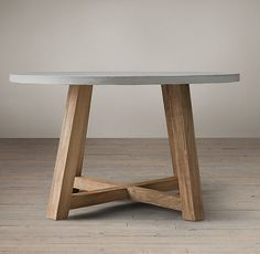 Love the idea of a circular table! Also love these colors. Salvaged Wood & Weathered Concrete Beam