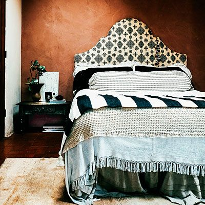 When vintage pieces are hard to find, use fabrics that mimic the motifs of original textiles. The headboard is covered by a pattern similar to one the homeowner saw in Morocco.