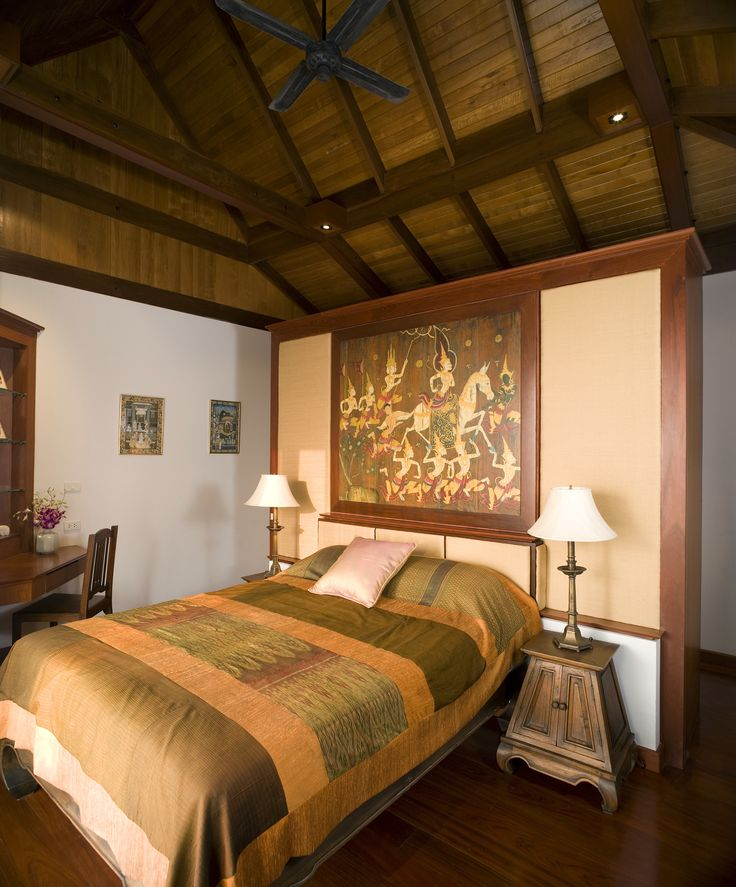 Somewhat tropical bedroom with antique dark wood bedside tables, vaulted wood ceilings and a lovely redwood floor. They like their wood. #hardwood #bedrooms #woodfloors