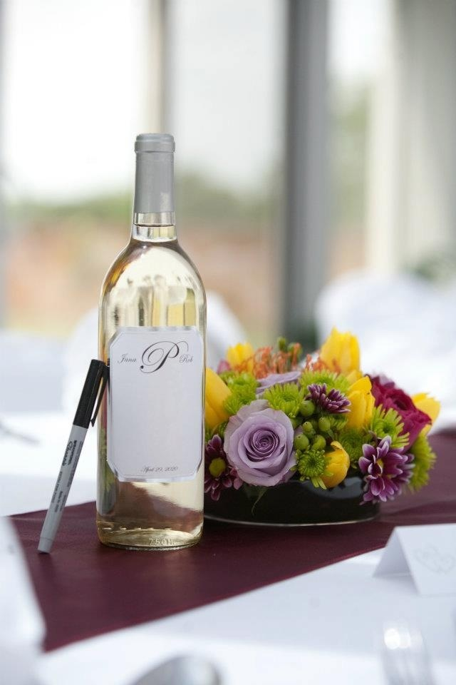 Each table centerpiece had a bottle of wine that we made ourselves with a label for the guests to sign that sat at that table. Each year on our anniversary we will open a bottle of wine and see the names of who was at our wedding