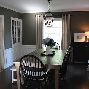 dining room slate with white trim and tan curtains