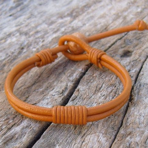 Henna color 3mm leather cord and 1mm cord.  Wood bead 10mm used as toggle.  This Henna Leather Adjustable Bracelet fits, 6-8 inch, 16-20cm  wrist (re-tie knot to adjust size) and is 8mm, just over .25 inch wide.