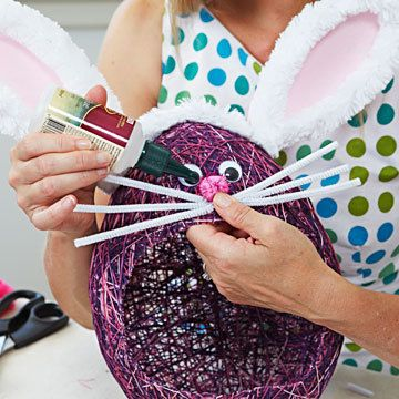 string baskets made around a balloon. Add little chocs to the balloon before blowing it up.