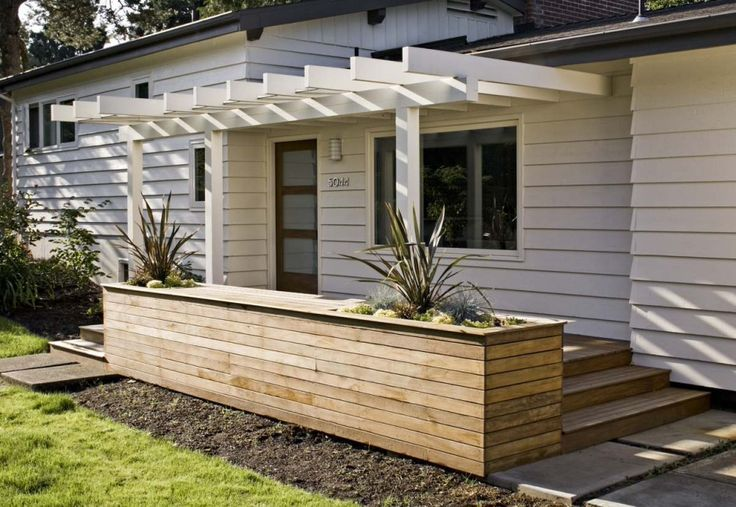 Inspiring Exterior Decor Using Planter Boxes Ideas: Midcentury Exterior With Deck Plus Planter Boxes In Front Door Also Front Porch With Light Filled And Pergola Also White Walls With Wood Siding Plus Concrete Walk Also Grass ~ nutrisespas.org Architecture Inspiration