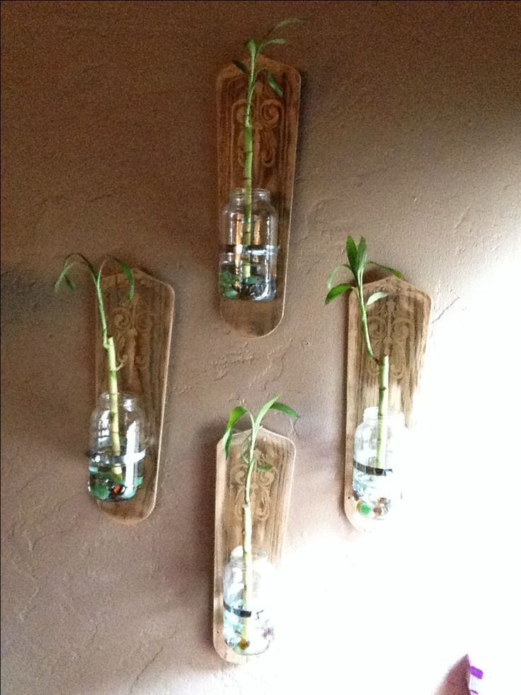 I recycled the fan blades of an old ceiling fan, (we have central air so we don't need them anymore) and situated some mason jars on them. You can put anything you want in them but for this project I placed bamboo and decorative rocks.