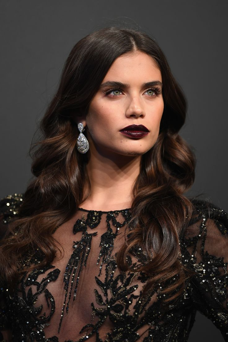 Portugese model Sara Sampaio went goth chic in a revealing black mesh gown with beading, and a dark purple brown lipstick. She wore Chopard diamond earrings. As seen at the Chopard Space Party. For glamour celebrity fashion Cannes Film Festival red carpet jewellery spotting travel here: http://www.thejewelleryeditor.com/jewellery/top-5/cannes-film-festival-red-carpet-jewellery-day-two/ #jewelry