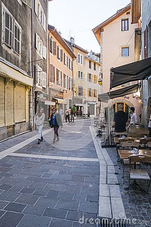 Street with pubs  in small  town Annecy,France. Old street and people on street market .  http://en.wikipedia.org/wiki/Annecy