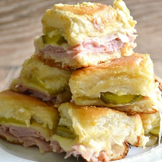 Cuban sliders! Ham, swiss cheese, dill pickles on slider buns topped with a dijon mustard spread!