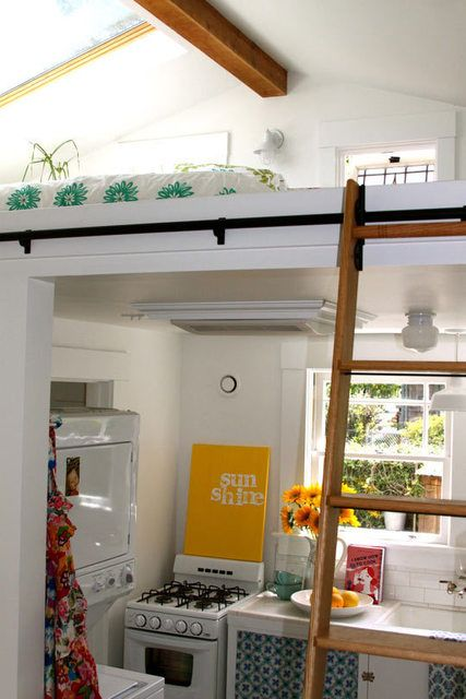 This cottage kitchen is so adorable, look at that loft above it? Ah, the cuteness.