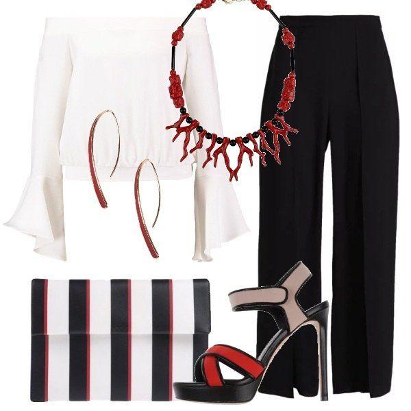 Outfit composto da blusa che lascia scoperte le spalle con maniche a campana, pantaloni lunghi con spacchi laterali e sandalo con tacco a stiletto. Completano il look la borsa a righe, gli orecchini rigidi e la collana con gancio a maglia regolabile.