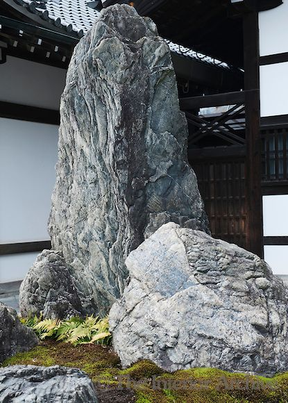 A rock arrangement on a bed of moss stands by the entrance to the 14th century Zen garden at Tenryu-ji Temple, Kyoto