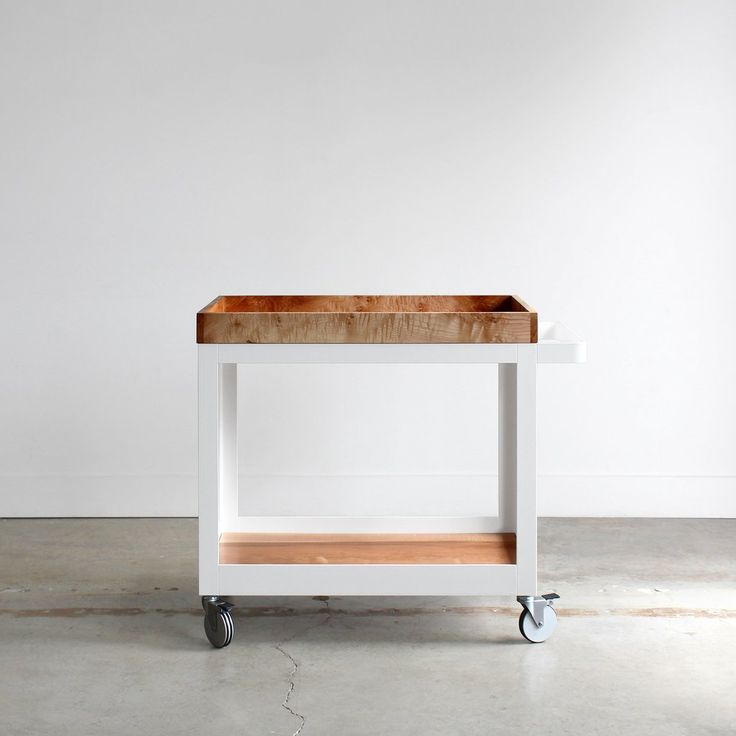 The Farmhouse Modern Serving Cart was conceived of as a multi-functional moveable piece that transcends the simple category of 'bar cart.' This serving cart can be used not only for spirits and glassw
