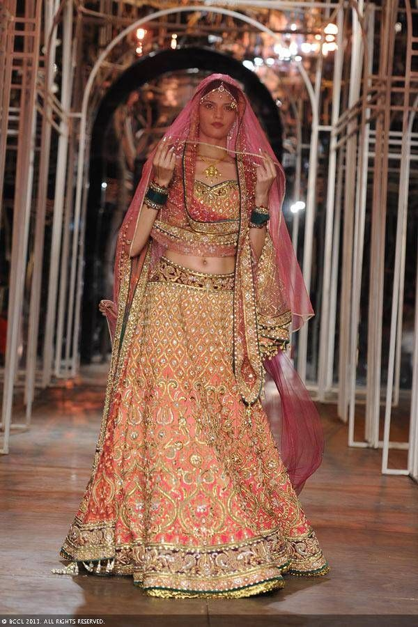 A model showcases a creation by designer Tarun Tahiliani during the Grand Finale of the India Bridal Fashion Week (IBFW) 2013, held in New Delhi.