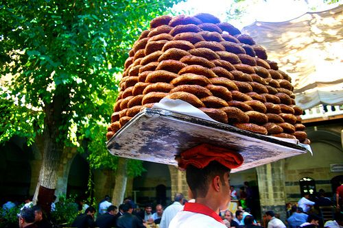 Street food from Turkey.  Kahvalti, or 'before coffee'.  Most of us would shudder at the prospect of anything before coffee but this actually means breakfast, and breakfast can be grabbed from the street in the form of a giant bread polo called simit, reminiscent of a bagel really, but tasty all the same.  Having one with a strong Turkish coffee, or kiwi tea, is even better.