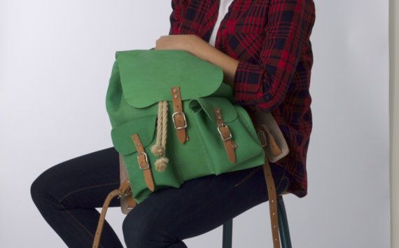 Leather backpack DIY package with drawstring, 2 pockets and real belt closures. Pre-cut stitching holes for easy hand sewing.