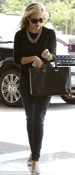 Morning jitters: Reese clasped a large cup of coffee as she arrived for a meeting in LA