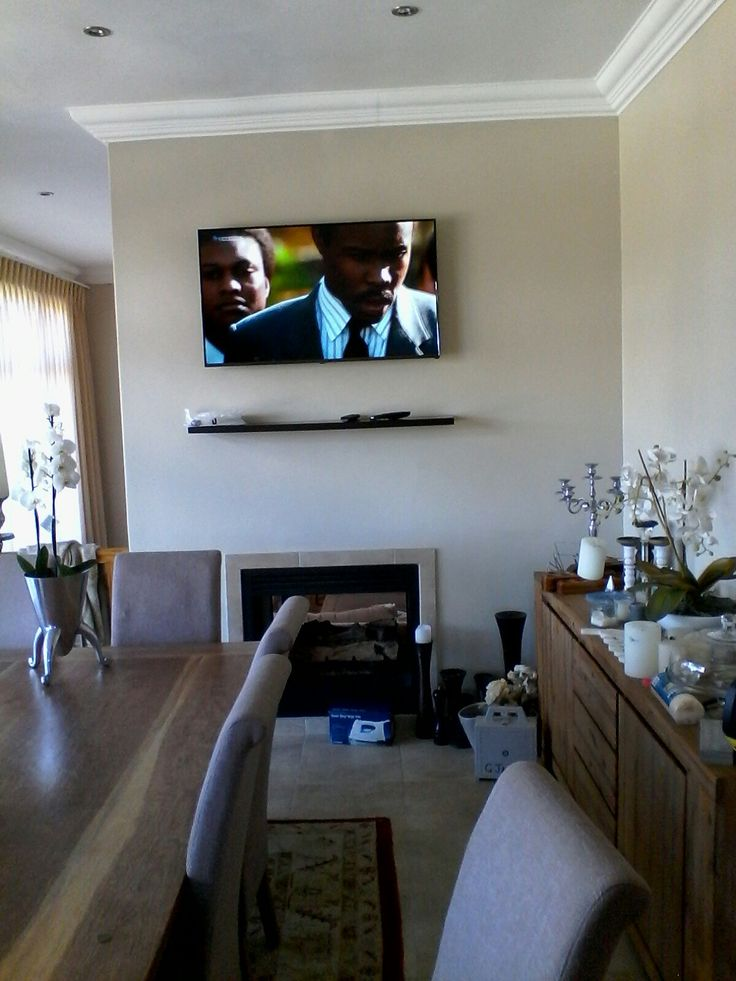 Tv wall mounted with floating shelf. Connected to Dstv Explora decoder via 10m  HDMI  cable
