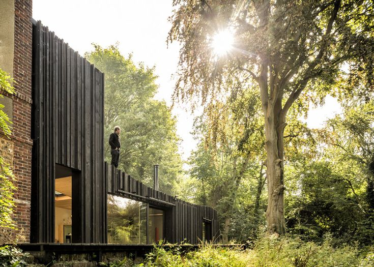 The Black House in Normandy, designed by Marchi Architectes. Photo by Fernando Guerra.