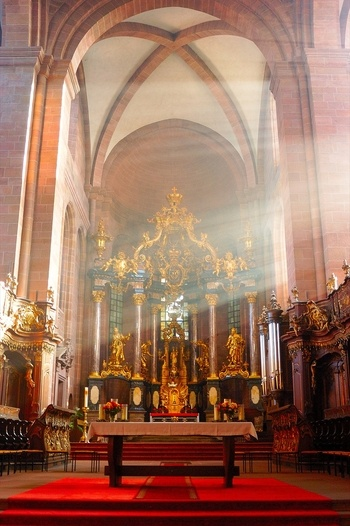 Worms Cathedral (Kaiserdom) - Worms, Germany  Sunbeams illuminate the Baroque high altar.