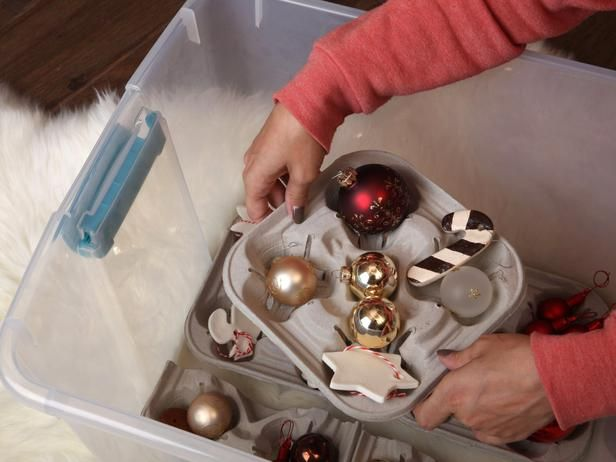 Tip #3: That's a latte storage! Don't throw away your beverage trays. They make great cradles for delicate ornaments. Because they're mobile, they're also very handy when decorating the tree. Now you don't have to return to the bin after each ornament. | 7 Clever Ways to Store Holiday Decorations with Upcycled Items >> http://www.diynetwork.com/decorating/7-clever-ways-to-store-christmas-decorations-with-upcycled-items/pictures/index.html?soc=pinterest