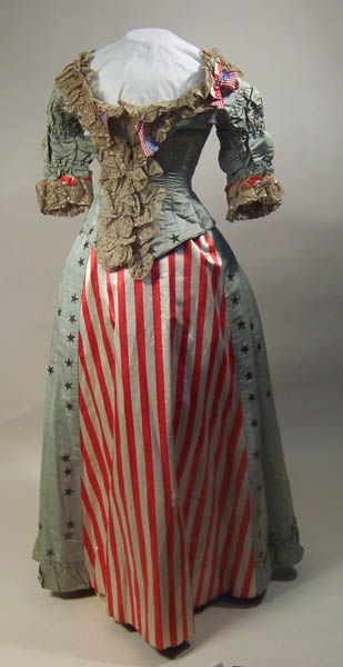 """The period between 1876 (the hundredth anniversary of the signing of the Declaration of Independence) and 1883 (the hundredth anniversary of the end of the Revolutionary War) saw a huge number of American themed fancy dress balls.  This beautiful Stars & Stripes themed dress was made for such a ball between between 1880 and 1882."""