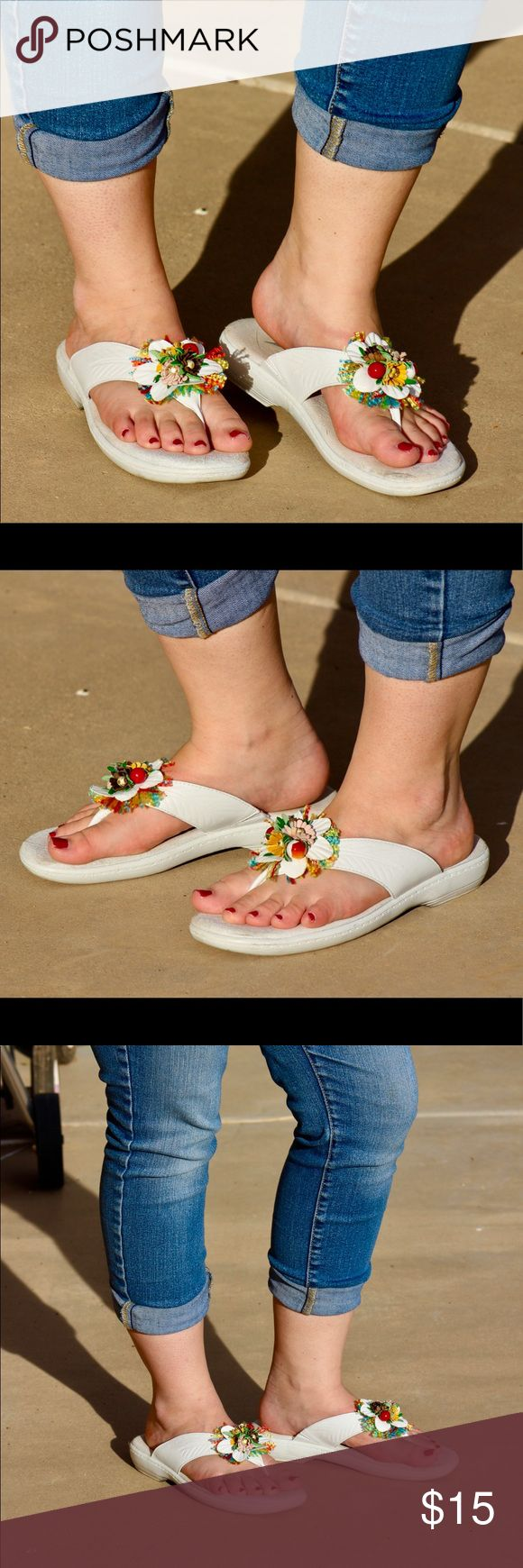 White Propét Sandles These lightly used shoes have a squishy sole with thick leather straps and a colorful decorative flower on the front. Go great with everything! Open to negotiations! Propet Shoes Sandals