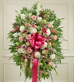 Deepest Sympathies Pastel Standing Spray Convey your deepest sympathies and continued support with this vibrant standing spray. Expertly crafted from an assortment of pastel blooms, it's a comforting